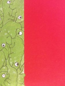A red rectangle covers over half the page squishing the green lizards, which don't look very happy